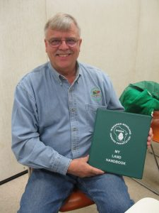 WWOA President, Steve Ring, shows off his copy of the My Land Handbook. He encourages members to fill out their own copy and personalize it to their needs.